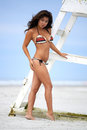 Asian beauty on beach beautiful young wearing colorful bikini new jersey in front lifeguard tower Stock Photo