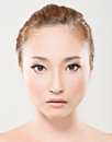 Asian beauty face closeup portrait with clean and fresh elegant lady studio shot Stock Photos