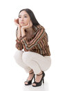 Asian beauty squat and feel boring full length portrait isolated on white background Stock Photos