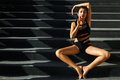 Asian in a black bathing suit on the stairs Royalty Free Stock Photography
