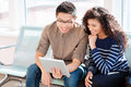 Asian boy and african american girl are using tablet computer Royalty Free Stock Photo