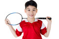 Asian boy in badminton action Royalty Free Stock Photo