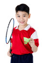 Asian boy in badminton action Royalty Free Stock Photo
