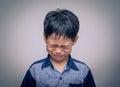 Asian boy crying over dark background Stock Image