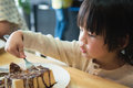 Asian boy eating honey toast Royalty Free Stock Photo