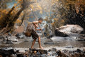Asian boy fishing in creeks, Children fight life Royalty Free Stock Photo