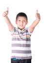 Asian boy giving you thumbs up over white background isolated Royalty Free Stock Image