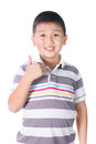 Asian boy giving you thumbs up over white background isolated Royalty Free Stock Photo