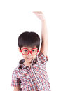 Asian boy growing tall and measuring himself on white background Royalty Free Stock Photo
