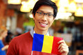 Asian boy holding flag of romania cheerful young Royalty Free Stock Photography