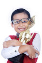 Asian boy holding tropy isolated is hugging a trophy on white Stock Images
