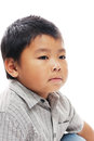 Asian boy looks serious Royalty Free Stock Photo