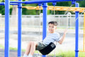 Asian boy play with swinging. with swinging. Royalty Free Stock Photo
