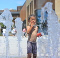 A asian boy play by water fountain Stock Photo