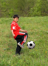 Asian boy playing football Stock Photo
