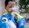 Asian boy playing soap bubble Royalty Free Stock Image