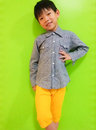 Asian boy the portrait of cute an on green background Royalty Free Stock Photography