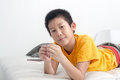 Asian boy resting comfortably on his bed at home Royalty Free Stock Image