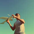Asian boy running airplane model vintage retro style under blue sky Stock Images