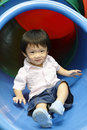 Asian boy on slide Stock Photos