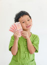 Asian boy thinking with holding money thai on hand over white background Stock Image