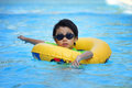 Asian boy in tube learning to swim Royalty Free Stock Photo