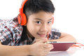 Asian boy ware headphone and playing the cell phone Royalty Free Stock Photo