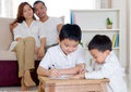 Asian boy writing boys on papers Royalty Free Stock Photos