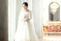 Asian bride in the wedding dress Stock Image