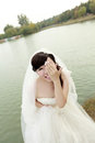 Asian bride in the wedding dress Stock Photo