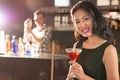 Asian brunette portrait of young in the bar Royalty Free Stock Images