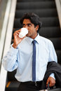 Asian business executive having a cup of tea Stock Images