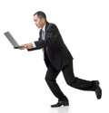 Asian business man holding laptop and running full length isolated on white Royalty Free Stock Photography