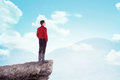 Asian business man standing on the top of the mountain Royalty Free Stock Photo