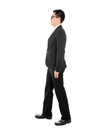 Asian business man walking full body side view of isolated on white background Royalty Free Stock Photos