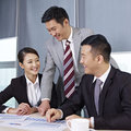 Asian business people discussing in office Stock Photography