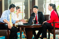 Asian Business People At Meeti...