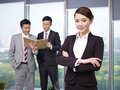Asian business people portrait of a young businesswoman with colleagues in background Royalty Free Stock Photo