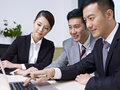 Asian business people a team of working together in office Royalty Free Stock Photo