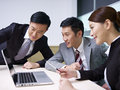 Asian business people a team of working together in office Stock Photography