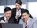 Asian business people a team of working together in office Stock Photo