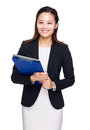 Asian business woman with clipboard and laptop computer isolated on white Stock Images