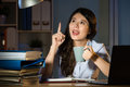 Asian business woman happy idea working overtime late night Royalty Free Stock Photo