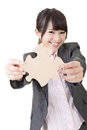 Asian business woman holding a piece of puzzle closeup portrait on the white background Royalty Free Stock Photography