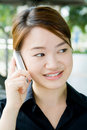 Asian business woman with phone Royalty Free Stock Photo