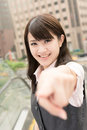 Asian business woman point you closeup portrait city Royalty Free Stock Photo