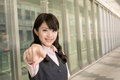 Asian business woman point you closeup portrait city Royalty Free Stock Photos