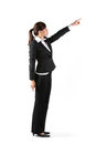 Asian business woman pointing at 'Copy' space. Royalty Free Stock Photography