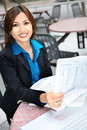 Asian Business Woman Reading Newspaper Stock Photography