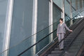 Asian business woman stand at escalator in modern building taipei taiwan Royalty Free Stock Image